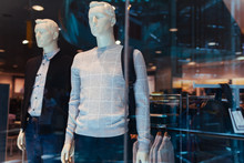Manikins Dressed In Male Clothes And Accessories On Showcase Of A Store In Shopping Center. Black Friday. Sales Concept