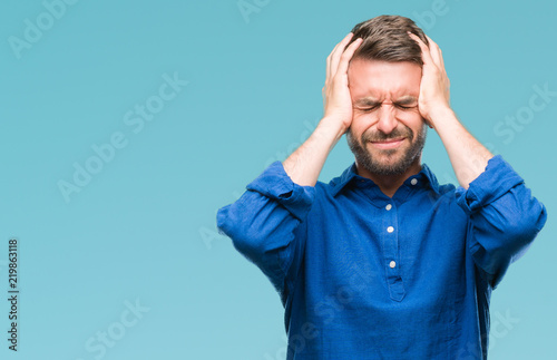 Young handsome man over isolated background suffering from headache desperate and stressed because pain and migraine Wallpaper Mural