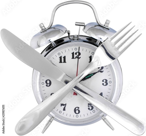 Foto Alarm Clock And Crossed Utensils - Isolated