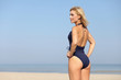 female enjoying sunny day on beach