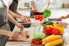 Female Chef Preparing Meat On ...