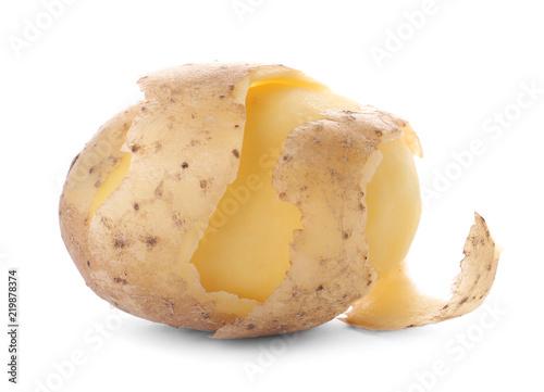 Ripe half-peeled organic potato on white background