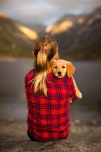 Young Girl Holding Her Golden ...