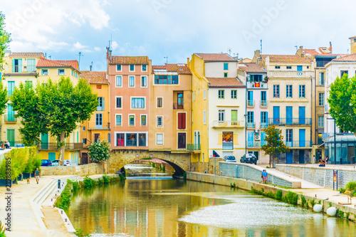 Canal de la robine flowing through the city center of Narbonne, France