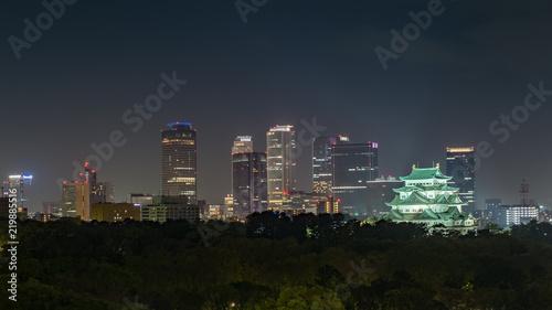 Fotografie, Obraz  Nagoya castle and Nagoya station towers view from Meijo kouen