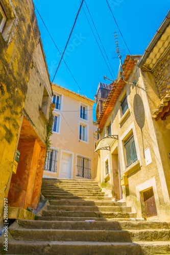Foto op Plexiglas Trappen a narrow street in Orange in France
