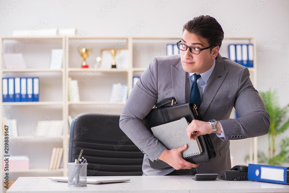 Fototapeta Businessman in industrial espionage concept