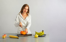 Girl Is Cutting A Pumpkin On The Table
