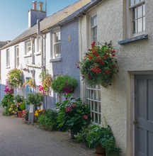 Quaint Row Of Cottages On A Small Street In The Pemrbrokeshire Town On Tenby In South Wales