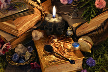 Still Life With Antique Witch Book, Black Candle And Ritual Objects. Mystic Background With Ritual Esoteric Objects, Occult, Fortune Telling And Halloween Concept