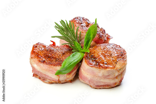 Papiers peints Nature Pork fillet wrapped in bacon, isolated on white background.