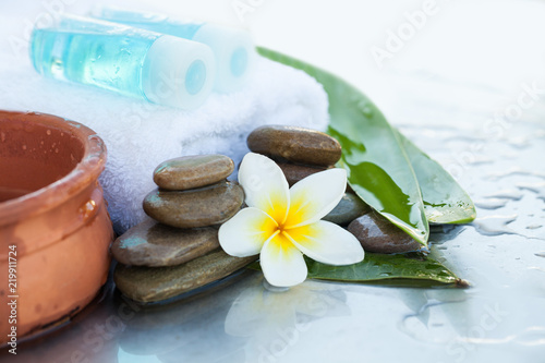 Staande foto Spa Two bottles with oil for massage. Spa concept with flowers and leaves