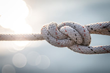 Sailor Knot And Rope In Front Of Beautiful Background