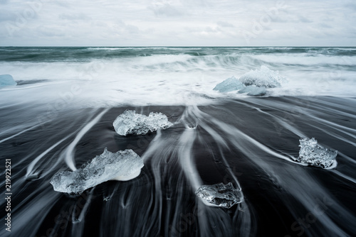 Poster Gris Ice on the beach with black sand in Iceland