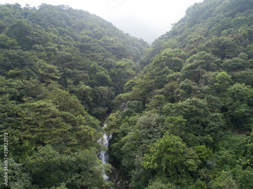 Poster Khaki Aerial View of Waterfall in the Tropical Rainforest Mountains