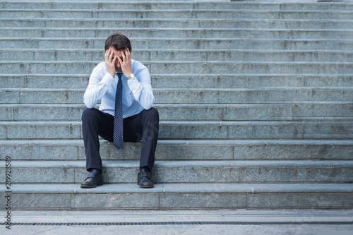 Desperate alone businessman after big fail sitting on the stairs Canvas Print