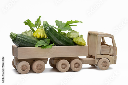 Truck with pattypan squash and squash. Children's wooden toy.