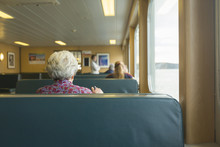 Older Woman Sitting On A Ferry...