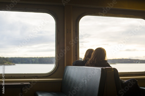 Two girls enjoying the view from their seats on a ferry in the San Juan Islands.