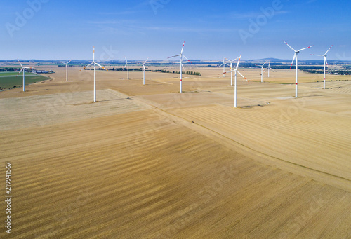 aerial view to fields and wind generators in Germany