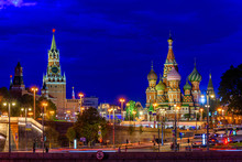 Spasskaya Tower, Moscow Kremlin And Saint Basil S Cathedral At Night In Moscow, Russia. Architecture And Landmarks Of Moscow. Postcard Of Moscow