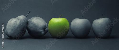 Fototapeta Close-up of green apple between gray fruit, still life obraz