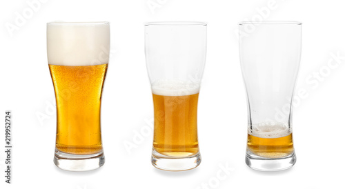 Photo Glasses with different amount of beer on white background