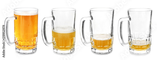 Fotobehang Alcohol Mugs with different amount of beer on white background