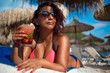 Woman relaxing on luxury beach with cocktail.ummer Concept