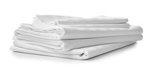 Stack Of Clean Bed Sheets On W...