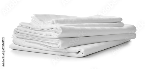 Obraz Stack of clean bed sheets on white background - fototapety do salonu