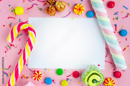 Fototapeta  Frame for the text on the background of different, sugar, children's sweets
