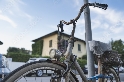 Vintage bicycle parking with shopping basket