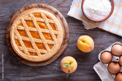 Tela Tart with peach jam on wooden rustic table