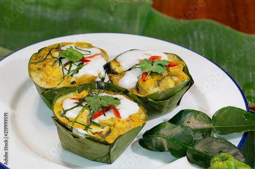 Steamed fish with curry paste (Thai language Hor mok) in banana leaf bowl Thai food