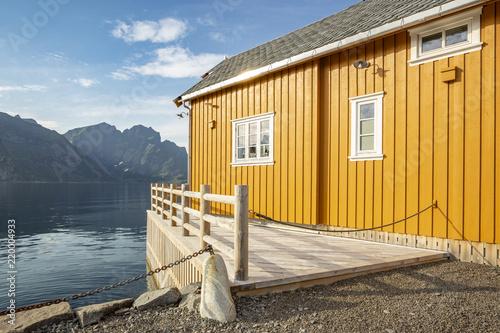 Obraz na płótnie Yellow rorbu in small island Sakrisoy in Lofoten islands, Norway