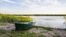 A Green Wooden Boat Near The Lake. Summer Sunset, Latvia
