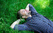 Closer To Nature. Nature Fills Him With Freshness And Inspiration. Man Unshaven Guy Lay On Green Grass Meadow. Guy Happy And Peaceful Enjoy Freshness Of Grass. Man Bearded Hipster United With Nature