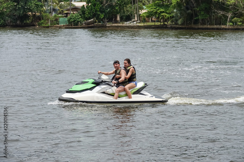 Keuken foto achterwand Water Motor sporten Happy young couple enjoying and having fun riding on a jet ski. Tropical coast of Sri Lanka