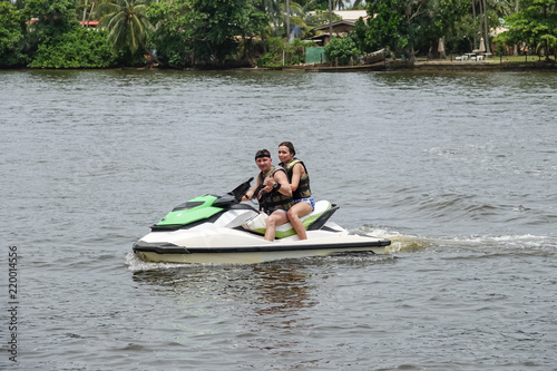 Poster Nautique motorise Happy young couple with thumbs up enjoying and having fun riding on a jet ski. Tropical coast of Sri Lanka