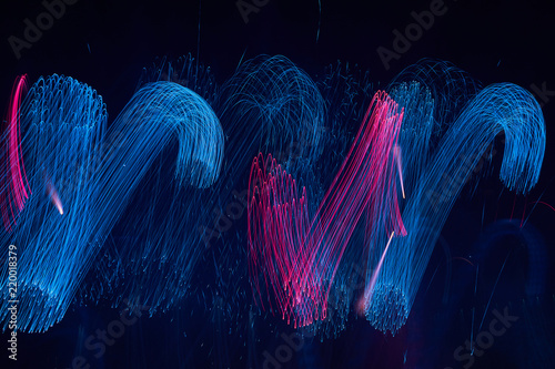 Obraz na plátně  Abstract light holiday color firework trails