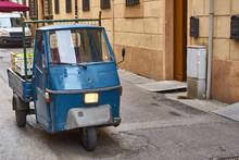 Blue Piaggio Ape Driving Throu...