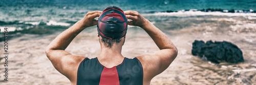 Cuadros en Lienzo Swimmer getting ready for open ocean swim race competition during triathlon