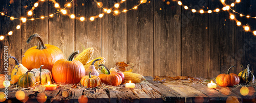 Thanksgiving With Pumpkins And Corncob On Wooden Table