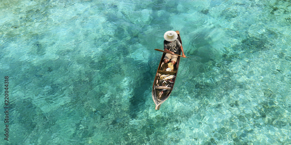 Fototapeta Fisherman in his boat  on turquoise sea