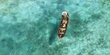 Fisherman In His Boat  On Turq...