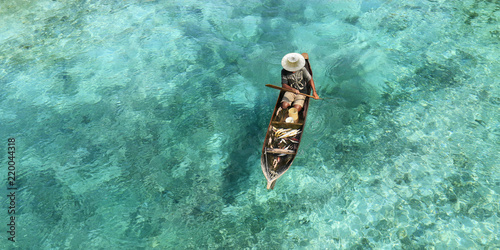 Fisherman in his boat  on turquoise sea Wallpaper Mural