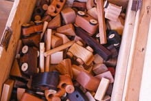 Wooden Toys On A Wooden Box. Close-up Hands.