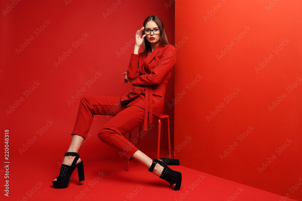 Fototapeta Fashion young woman in red suit.