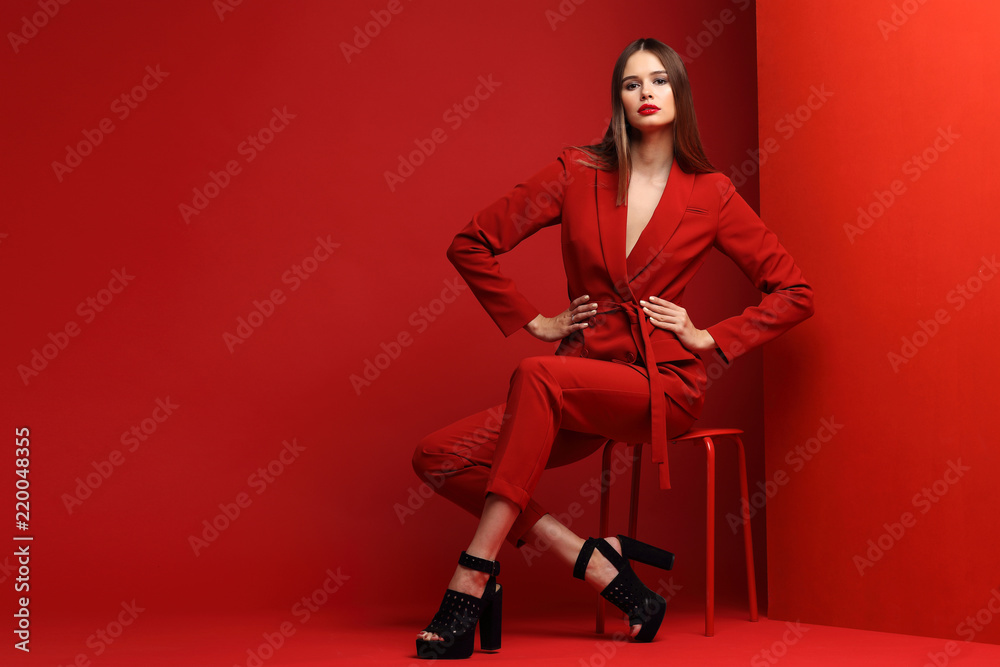 Fototapety, obrazy: Fashion young woman in red suit.